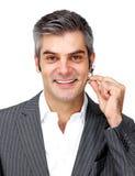 Positive businessman using headset Stock Image