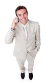 Positive businessman using a mobile phone Stock Image