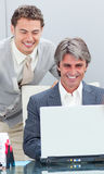 Positive businessmen working at a computer Royalty Free Stock Image