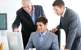 Positive businessmen working at a computer Royalty Free Stock Images