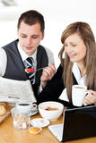 Positive businesspeople having breakfast reading Stock Photography