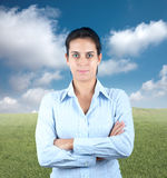 Positive businesswoman. In a green field Stock Photography