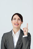Positive businesswoman pointing at a copyspace Stock Photo