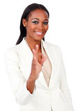 Positive businesswoman showing OK sign Stock Photography
