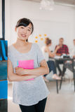 Positive businesswoman standing in office Stock Photography