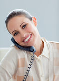 Positive businesswoman talking on phone Stock Images