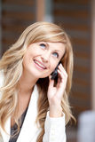 Positive businesswoman talking on phone Royalty Free Stock Photos