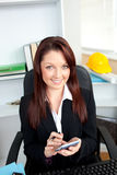 Positive businesswoman using her calculator Royalty Free Stock Photos
