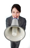 Positive businesswoman using a megaphone Stock Photos