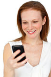 Positive businesswoman using a mobile phone Stock Photography
