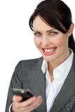 Positive businesswoman using a mobile phone Royalty Free Stock Photo