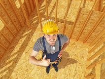 Positive carpenter in construction site Royalty Free Stock Image