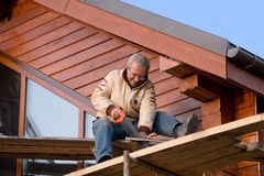 Positive carpenter with handsaw Stock Image