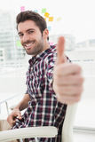Positive casual businessman with thumbs up Royalty Free Stock Photography