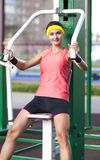 Positive Caucasian Female Athlete in Good Fit Having Training Outdoors. Fitness and Sport Concepts.Positive Caucasian Female Athlete in Good Fit Having Training Stock Photos