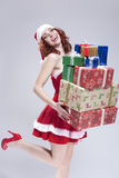Positive Caucasian Snow Maiden Holding a Big Stack of Gift Boxes on Hands and Smiling Royalty Free Stock Photos