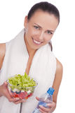 Positive caucasian woman with salad and water Stock Photography