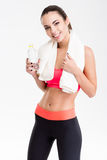 Positive charming fitness girl with white towel on her neck Royalty Free Stock Image