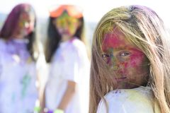 Positive and cheerful. colorful neon paint makeup. children with creative body art. fashion youth party. Optimist stock photography