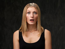 Positive and cheerful girl with her mouth open Royalty Free Stock Photos