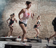 Positive and cheerful people doing exercise Stock Photo