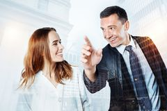 Satisfied smiling client listening to a specialist. Positive. Cheerful satisfied happy client listening attentively to a specialist and smiling Royalty Free Stock Images