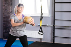 Positive cheerful woman training with a ball Stock Images
