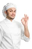 Positive chef with ok sign isolated. Professional chef in white uniform and hat with okay sign isolated stock photos