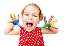 Positive child with colorful hands Royalty Free Stock Photo