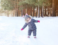 Positive child having fun in winter Royalty Free Stock Image