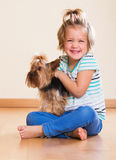 Positive child holding Yorkshire Terrier Royalty Free Stock Image
