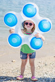 Positive child with inflatable circle Royalty Free Stock Photo