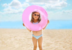 Positive child with inflatable circle on the beach Royalty Free Stock Images