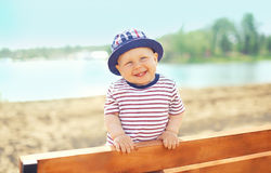 Positive child wearing a hat having fun outdoors Stock Image