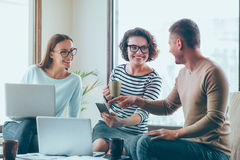 Positive colleagues sitting in the office royalty free stock photo
