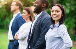 Positive colleagues standing outside stock images