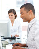 Positive colleagues working at a their computer Royalty Free Stock Photo