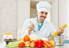 Positive cook  cooking with spaghetti Stock Images