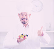 Positive cook with greek salad Stock Image