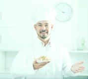 Positive cook with porridge Stock Photography