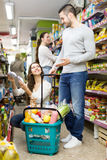 Positive couple buying groceries Stock Photography