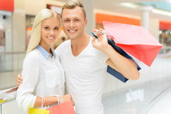 Positive couple holding packages Royalty Free Stock Image