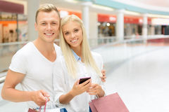 Positive couple holding packages Stock Photography