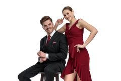Positive couple laughing and being dressed elegant stock photography
