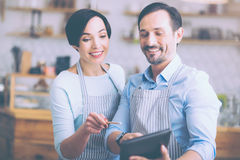 Positive couple manging their little business Royalty Free Stock Photo