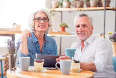 Positive couple resting in the cafe Stock Images