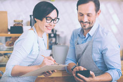 Positive couple running their little business Stock Image