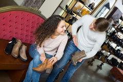 Positive  couple shopping at shoe store Stock Photography