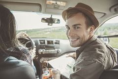 Positive couple is traveling across country stock image
