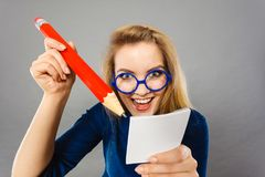 Crazy woman holds big pencil in hand Royalty Free Stock Photos
